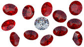 Large diamond among red rubies — Stock Photo