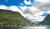 Mountains, village and Norwegian fiord — Stock Photo