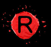 Red blob R letter over black background — Stock Photo