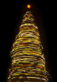 árbol de navidad giratorio borrosa — Foto de Stock