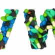 Pharmacy font W and V pills letters — Stock Photo