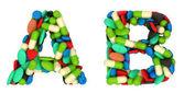 Gezondheidszorg lettertype een en b pillen brieven — Stockfoto