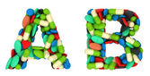 Healthcare font A and B pills letters — Stock Photo