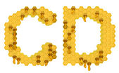 Honey font C and D letters isolated — Stock Photo