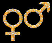 Golden gender symbols inlaid with diamonds — Stock Photo