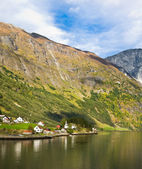 Life in Norway: fjord, mountains and village — Stock Photo