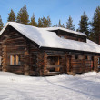Snow-covered chalet — Stock Photo