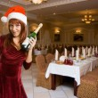 Girl in a Christmas hat with champagne — Stock Photo #4004211