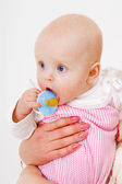 Infant with a pacifier — Stock Photo