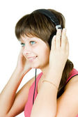 Beautiful girl in headphones listens to music — Stock Photo