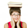 Royalty-Free Stock Photo: Girl in glasses with books on head