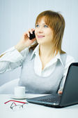 Happy business woman in the office — Stock Photo