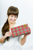 Young woman with a gift — Stockfoto