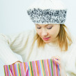 Girl wearing a winter cap. Winter Shopping — Stock Photo