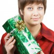 Stock Photo: Portrait of an attractive young woman with a gift