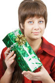 Portrait of an attractive young woman with a gift — Stock Photo