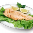 Trout fillet with lettuce - Stock Photo