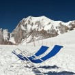 Stock Photo: Deck-chairs beneath Mont Blanc