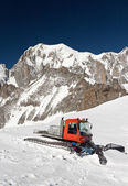 Snowcat and mont Blanc — Stock Photo