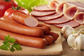Sausages and meat — Stock Photo