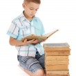 Young boy reading a old book — Stock Photo