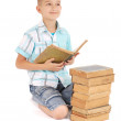 The young boy dreams near the open old book — Stock Photo