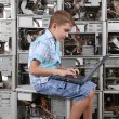 The boy plays with laptop — Stock Photo
