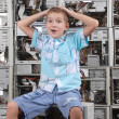 The surprised boy on a background of a wall from old computer ca — Stock Photo #4243296