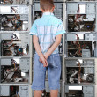 Boy faces to a wall from old computer case — Stock Photo #4243308