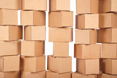 Background stacked cardboard boxes — Stockfoto