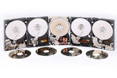 Many Open Hard drives. Are reflected in disks. — Stock Photo