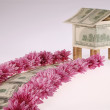 Stock Photo: It is dear from dollars and flowers approaches to house