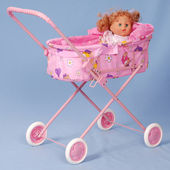 Toy baby buggy on blue background. — Stock Photo