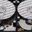 Stock Photo: Binary code on two HDD