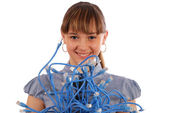 Girl before itself holds the big sheaf of network wires RJ45. — Stock Photo