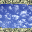 100 dollar frame Inside the beautiful sky and clouds - Stock Photo