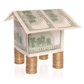 The house from dollars costs on coins. — Stock Photo