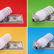 Luminescent lamp on hundred dollars — Stock Photo