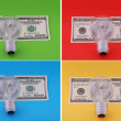 Electric lamp on hundred dollars — Stock Photo