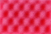 Red texture cellulose foam sponge — Stock Photo