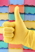 Yellow rubber glove — Stock Photo