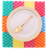 Plate with the gold spoon — Стоковое фото