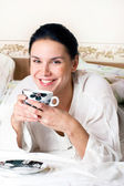 A young woman with a cup of coffee — Stock Photo