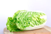 Fresh cabbage on the wood desk — Stock Photo