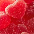 Red fruit candy in the form of the heart - Stock Photo