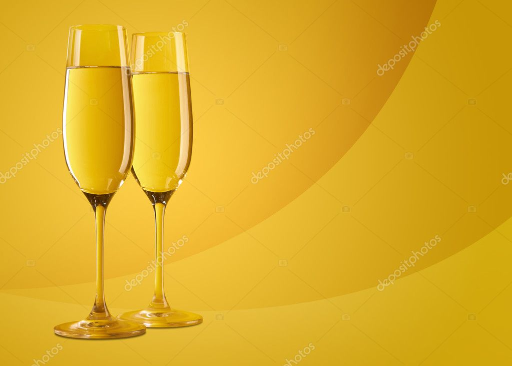 Two glasses of champagne on abstract yellow background — Stock Photo #4350091