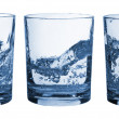 Set of glasses water splash - Stock Photo