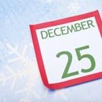 Christmas Calendar Page on Snowflake Background — Stock Photo