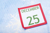 Christmas Calendar Page on Snowflake Background — Stock Photo