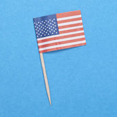 American Flag Toothpick on a Blue Background. — Stock Photo